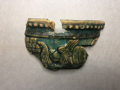 <em>Vessel Fragment</em>, 305 B.C.E.-395 C.E. Faience, 1 9/16 x 1 1/4 x 3/16 in. (4 x 3.2 x 0.5 cm). Brooklyn Museum, Anonymous gift, 69.112.5. Creative Commons-BY (Photo: , CUR.69.112.4_69.112.5_69.112.6_69.112.7_69.112.8_view01.jpg)