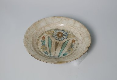 <em>Plate</em>, early 17th century. Ceramic, Kubachi ware; fritware, painted in black, blue and turquoise green with red and yellow slips under a transparent glaze, 1 5/8 x 7 9/16 in. (4.2 x 19.2 cm). Brooklyn Museum, Gift of Mrs. James Leipner, 69.120.1. Creative Commons-BY (Photo: Brooklyn Museum, CUR.69.120.1.jpg)