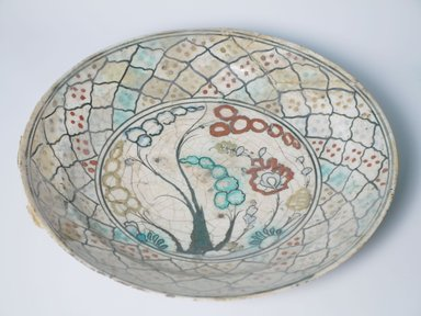 <em>Plate</em>. Ceramic, Kubachi ware; fritware, painted in black, blue and turquoise green with red and yellow slips under a transparent glaze, 2 1/2 x 13 3/8 in. (6.3 x 34 cm). Brooklyn Museum, Gift of Mrs. James Leipner, 69.120.2. Creative Commons-BY (Photo: Brooklyn Museum, CUR.69.120.2_detail1.jpg)