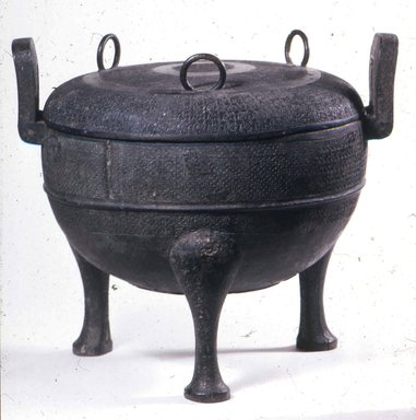 <em>Tripod Food Vessel (Ding)</em>, ca. 5th-3rd century B.C.E. Bronze, 11 3/8 x 11 1/2 in. (28.9 x 29.2 cm). Brooklyn Museum, Gift of Mr. and Mrs. Arthur Wiesenberger, 69.164.14. Creative Commons-BY (Photo: Brooklyn Museum, CUR.69.164.14_view2.jpg)