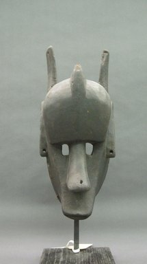 Bamana. <em>Hyena Mask, Kore' Society</em>, late 19th-early 20th century. Wood, 17 1/2 x 8 x 9 in. (without base) (44.4 x 20.3 x 22.9 cm). Brooklyn Museum, Gift of Dr. and Mrs. Milton Gross, 69.166.4. Creative Commons-BY (Photo: Brooklyn Museum, CUR.69.166.4_overall.jpg)
