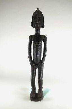 Dogon. <em>Figure of a Standing Female</em>, late 19th or early 20th century. Wood, 22in. (55.9cm). Brooklyn Museum, Robert B. Woodward Memorial Fund and Gift of Arturo and Paul Peralta-Ramos, by exchange, 69.39.1. Creative Commons-BY (Photo: Brooklyn Museum, CUR.69.39.1_front_PS5.jpg)