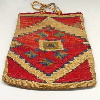 Nez Perce. <em>Twined Bag</em>, early 20th century. Cotton, wool, glass beads, hide, corn husk, 11 7/16 x 9 7/16in. (29 x 24cm). Brooklyn Museum, Gift of Mr. and Mrs. Francis T. Christy, 69.55.6. Creative Commons-BY (Photo: Brooklyn Museum, CUR.69.55.6_view1.jpg)