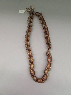 Tongan. <em>Girdle or Necklace</em>. Shell, seeds, nylon cord, 5 7/8 × 34 13/16 in. (15 × 88.5 cm). Brooklyn Museum, Gift of Dr. Elmina R. Lucke, 69.9.2. Creative Commons-BY (Photo: Brooklyn Museum, CUR.69.9.2_overall.jpg)