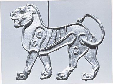 Persian. <em>Bracteate</em>, 6th-5th century B.C.E. Gold, 13/16 x 1 5/16 in. (2.1 x 3.4 cm). Brooklyn Museum, Gift of Mr. and Mrs. Alastair Bradley Martin, 70.142.8. Creative Commons-BY (Photo: Brooklyn Museum, CUR.70.142.8_L_270_21_print_bw.jpg)