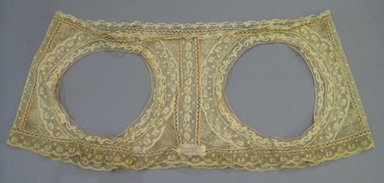 American. <em>Lampshade Cover</em>, early 20th century. Lace with piping of silk, 25 x 10 3/8 in. (63.5 x 26.3 cm). Brooklyn Museum, Gift of Mrs. William Randolph Hearst, Jr., 70.165. Creative Commons-BY (Photo: Brooklyn Museum, CUR.70.165.jpg)