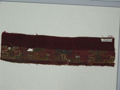 Coastal Wari (attrib by Nobuko Kajatani, 1993). <em>Mantle, Fragment</em>, 600-1000 C.E. Cotton, camelid fiber, 3 15/16 x 14 15/16 in. (10 x 38 cm). Brooklyn Museum, Gift of Ernest Erickson, 70.177.54. Creative Commons-BY (Photo: Brooklyn Museum, CUR.70.177.54_view1.jpg)