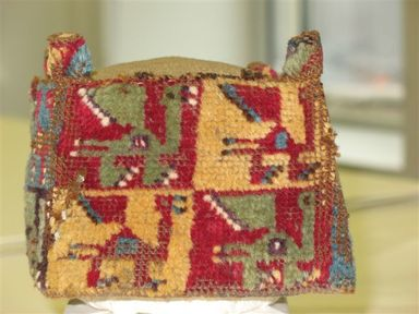 Coastal Wari. <em>Hat,  fragment</em>, 600-1000 C.E. Textile. Camelid fiber, 5 7/8 x 3 15/16 in. (15 x 10 cm). Brooklyn Museum, Gift of Ernest Erickson, 70.177.7. Creative Commons-BY (Photo: Brooklyn Museum, CUR.70.177.7_view1.jpg)