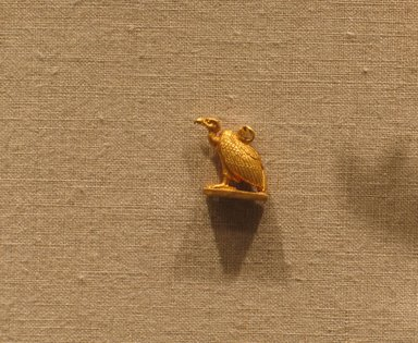 <em>Amulet in the Form of a Vulture</em>. Gold, 9/16 × 1/4 × 11/16 in. (1.5 × 0.6 × 1.7 cm). Brooklyn Museum, Charles Edwin Wilbour Fund, 70.91.1. Creative Commons-BY (Photo: Brooklyn Museum, CUR.70.91.1_wwg8.jpg)