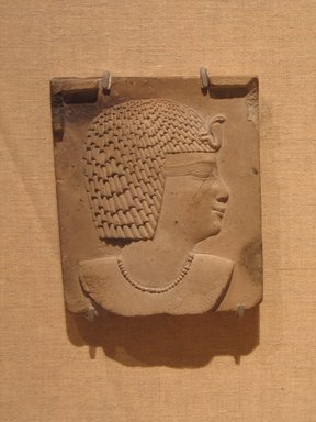 <em>Plaque of a Royal Head</em>, 4th century B.C.E. Limestone, 4 5/16 x 3 3/4 x 13/16 in. (11 x 9.6 x 2 cm). Brooklyn Museum, Charles Edwin Wilbour Fund, 70.91.2. Creative Commons-BY (Photo: Brooklyn Museum, CUR.70.91.2_wwg8.jpg)