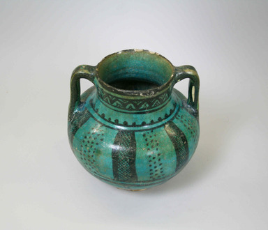 <em>Double-handled Jar</em>, 14th century. Glazed ceramic, 4 7/16 x 7 1/2 in. (11.3 x 19 cm). Brooklyn Museum, Gift of Elizabeth F. Babbott in memory of Dr. Frank L. Babbott, 71.113. Creative Commons-BY (Photo: , CUR.71.113_view02.jpg)