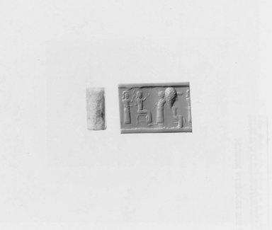 Ancient Near Eastern. <em>Cylinder Seal</em>, 12th-11th century B.C.E. Quartz, 9 13/16 x Diam. 1/2 in. (25 x 1.2 cm). Brooklyn Museum, Twentieth-Century Fox Fund, 71.115.12. Creative Commons-BY (Photo: Brooklyn Museum, CUR.71.115.12_NegA_print_bw.jpg)