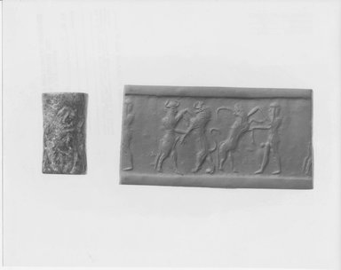 Ancient Near Eastern. <em>Cylinder Seal</em>, 2300 B.C.E. Serpentine, 15/16 x Diam. 1/2 in. (2.4 x 1.3 cm). Brooklyn Museum, Twentieth-Century Fox Fund, 71.115.1. Creative Commons-BY (Photo: Brooklyn Museum, CUR.71.115.1_NegA_print_bw.jpg)