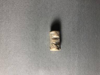 Ancient Near Eastern. <em>Cylinder Seal</em>, 2300 B.C.E. Marble, 1 1/16 × Diam. 9/16 in. (2.7 × 1.5 cm). Brooklyn Museum, Twentieth-Century Fox Fund, 71.115.4. Creative Commons-BY (Photo: , CUR.71.115.4_view01.jpg)