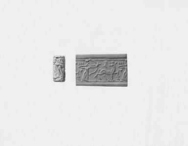 Ancient Near Eastern. <em>Cylinder Seal</em>, early 1st millennium B.C.E. Stone, glazed, 15/16 x Diam. 7/16 in. (2.4 x 1.1 cm). Brooklyn Museum, Twentieth-Century Fox Fund, 71.115.5. Creative Commons-BY (Photo: Brooklyn Museum, CUR.71.115.5_NegA_print_bw.jpg)