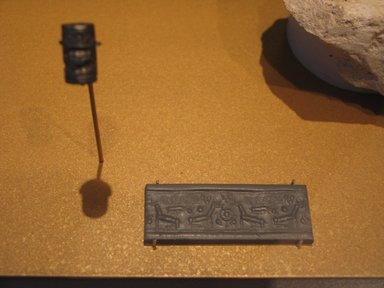 Ancient Near Eastern. <em>Western Asiatic Cylinder Seal with Running Spiral</em>, ca. 1450-1400 B.C.E. Hematite, 5/8 x Diam. 3/8 in. (1.6 x 1 cm). Brooklyn Museum, Twentieth-Century Fox Fund, 71.115.6. Creative Commons-BY (Photo: Brooklyn Museum, CUR.71.115.6_erg2.jpg)