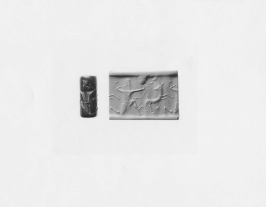 Ancient Near Eastern. <em>Cylinder Seal</em>, 7th century B.C.E. Serpentine, 1 1/8 x Diam. 1/2 in. (2.8 x 1.2 cm). Brooklyn Museum, Twentieth-Century Fox Fund, 71.115.9. Creative Commons-BY (Photo: Brooklyn Museum, CUR.71.115.9_NegA_print_bw.jpg)