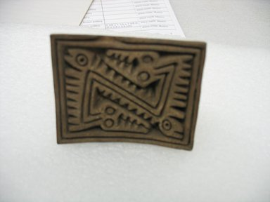 <em>Stamp</em>, 1000-1500. Ceramic, 2 1/8 x 2 x 2 5/8 in. (5.4 x 5.1 x 6.7 cm). Brooklyn Museum, Gift of Ernest E. Erickson, 71.174.14. Creative Commons-BY (Photo: Brooklyn Museum, CUR.71.174.14_view2.jpg)