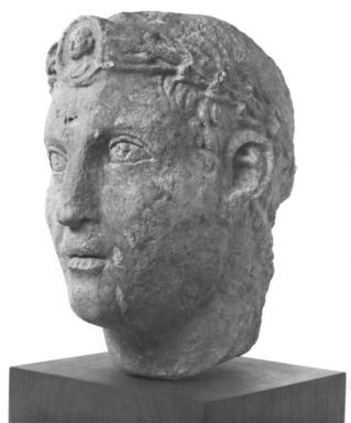 Syrian. <em>Head of a Priest</em>, 2nd century C.E. Limestone, 12 5/8 x 8 1/4 x 11 in. (32 x 21 x 28 cm). Brooklyn Museum, Gift of Mr. and Mrs. Carl L. Selden, 71.36. Creative Commons-BY (Photo: Brooklyn Museum, CUR.71.36_NegB_print_bw.jpg)