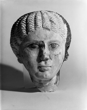 <em>Female Head</em>, 3rd century C.E. Limestone, plaster, pigment, 8 11/16 x 7 1/2 x 7 7/8 in. (22 x 19 x 20 cm). Brooklyn Museum, Charles Edwin Wilbour Fund, 71.87. Creative Commons-BY (Photo: Brooklyn Museum, CUR.71.87_NegA_bw.jpg)