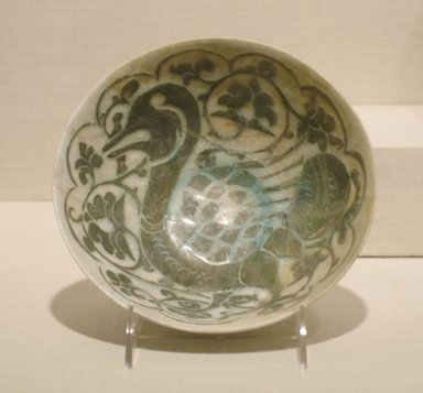 <em>Bowl with a Duck</em>, late 12th century. Ceramic, silhouette ware; fritware, decoration through a black slip under a transparent turquoise glaze, 3 3/8 x 4 13/16 in. (8.5 x 12.2 cm). Brooklyn Museum, Gift of Mr. and Mrs. Carl L. Selden, 72.132.1. Creative Commons-BY (Photo: Brooklyn Museum, CUR.72.132.1.jpg)