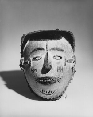 Idoma. <em>Face Mask</em>, 20th century. Wood, pigment, cloth fiber, 8 1/2 x 6 3/4 x 5 1/4 in. (21.5 x 17.2 x 13.4 cm). Brooklyn Museum, Gift of Dr. and Mrs. Abbott A. Lippman to the Jennie Simpson Educational Collection of African Art, 72.139. Creative Commons-BY (Photo: Brooklyn Museum, CUR.72.139_print_bw.jpg)