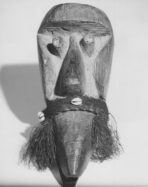 Possibly Dan. <em>Mask</em>, late 19th or early 20th century. Wood, fiber, shell, 12 x 6 x 4 3/4 in. (30.5 x 15.2 x 12.1 cm). Brooklyn Museum, Gift of Dr. and Mrs. Abbott A. Lippman to the Jennie Simpson Educational Collection of African Art, 72.172.1. Creative Commons-BY (Photo: Brooklyn Museum, CUR.72.172.1_print_bw.jpg)