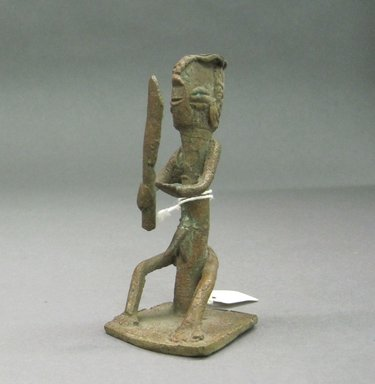 Yorùbá. <em>Male Figure</em>, late 19th to early 20th century. Copper alloy, 3 3/4 in.  (9.5 cm). Brooklyn Museum, Gift of David R. Markin, 72.49.2. Creative Commons-BY (Photo: Brooklyn Museum, CUR.72.49.2.jpg)