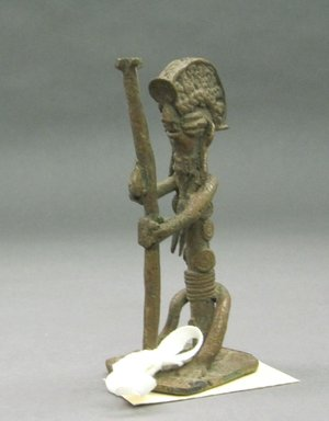 Yorùbá. <em>Seated Female Figure</em>, late 19th or early 20th century. Copper alloy, h: 4 1/2 in. Brooklyn Museum, Gift of David R. Markin, 72.49.3. Creative Commons-BY (Photo: Brooklyn Museum, CUR.72.49.3.jpg)