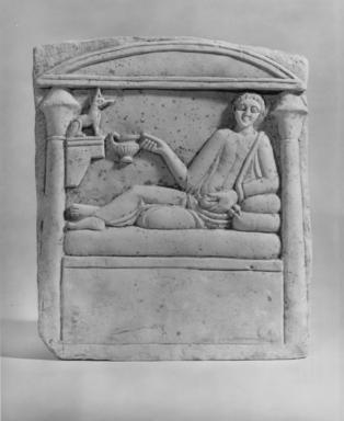 Roman. <em>Funerary Stela</em>, ca. 2nd century C.E. Limestone, 14 3/4 x 8 1/4 x 3 1/16 in. (37.5 x 21 x 7.8 cm). Brooklyn Museum, Charles Edwin Wilbour Fund, 72.60. Creative Commons-BY (Photo: Brooklyn Museum, CUR.72.60_NegC_print_bw.jpg)