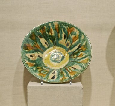 <em>Bowl with Splash Motif</em>, 10th century. Ceramic; earthenware, painted in splashes of black, brown, green, and yellow pigments on an incised white slip ground under a transparent glaze, 2 3/4 x 9 13/16 in. (7 x 25 cm). Brooklyn Museum, Gift of Alastair B. Martin, 72.86.2. Creative Commons-BY (Photo: Brooklyn Museum, CUR.72.86.2.jpg)