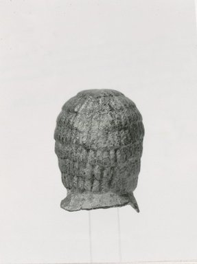 <em>Wig from a Statue</em>, ca. 800 B.C.E. Bronze, 3 × 2 3/16 × 2 5/16 in. (7.6 × 5.5 × 5.8 cm). Brooklyn Museum, Gift of Christos G. Bastis, 73.27. Creative Commons-BY (Photo: Brooklyn Museum, CUR.73.27_NegB_print_bw.jpg)