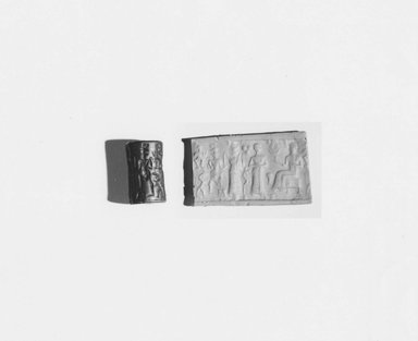 Ancient Near Eastern. <em>Cylinder Seal</em>, 18th-17th century B.C.E. Hematite, 3/8 x Diam. 1/4 in. (1 x 0.6 cm). Brooklyn Museum, Gift of the Leon and Harriet Pomerance Foundation, 73.31.3. Creative Commons-BY (Photo: Brooklyn Museum, CUR.73.31.3_NegA_print_bw.jpg)