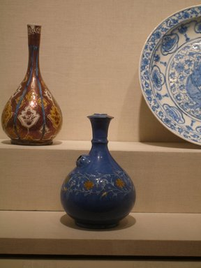 <em>Qaliyan (Water Pipe)</em>, 17th century. Ceramic; fritware, painted in white slip under a cobalt blue glaze, overglaze painted in ochre, 10 x 6 1/4 in. (25.4 x 15.9 cm). Brooklyn Museum, Special Middle Eastern Art Fund, 73.66.1. Creative Commons-BY (Photo: Brooklyn Museum, CUR.73.66.1.jpg)
