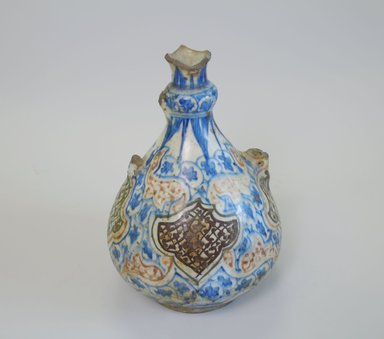 <em>Ewer</em>, late 17th century. Glazed ceramic, 8 7/8 x 6 5/16 in. (22.5 x 16 cm). Brooklyn Museum, Special Middle Eastern Art Fund, 73.66.2. Creative Commons-BY (Photo: Brooklyn Museum, CUR.73.66.2_view1.jpg)