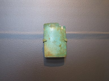 <em>Wall Tile from a Royal Funerary Structure</em>, ca. 2675-2625 B.C.E. Faience, 2 3/16 x 1 7/16 x 11/16 in. (5.6 x 3.6 x 1.8 cm). Brooklyn Museum, Charles Edwin Wilbour Fund, 73.84.3. Creative Commons-BY (Photo: Brooklyn Museum, CUR.73.84.3_erg2.jpg)