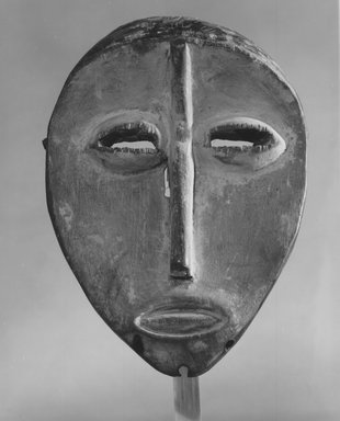 Lega. <em>Mask (Lukwakongo)</em>, late 19th or early 20th century. Wood, kaolin, pigment, fiber, 7 1/2 x 5 x 1 3/4 in. (19.1 x 12.7 x 4.6 cm). Brooklyn Museum, Gift of Marcia and John Friede, 74.121.6. Creative Commons-BY (Photo: Brooklyn Museum, CUR.74.121.6_print_front_bw.jpg)