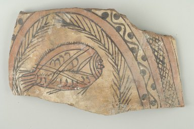Coptic. <em>Vessel Fragment with Fish</em>, 5th-6th century C.E. Clay, slip, 7 7/8 x 13 3/8 x 1/2 in. (20 x 34 x 1.3 cm). Brooklyn Museum, Gift of Dr. and Mrs. David Mintz and Charles Edwin Wilbour Fund, 74.157. Creative Commons-BY (Photo: Brooklyn Museum (in collaboration with Index of Christian Art, Princeton University), CUR.74.157_ICA.jpg)