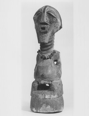 Songye. <em>Power Figure (Nkishi)</em>, late 19th or early 20th century. Wood, 27 x 7 1/4 x 8 1/2 in. (68.5 x 18.5 x 21.6 cm). Brooklyn Museum, Gift of Mr. and Mrs. Gustave Schindler, 74.174. Creative Commons-BY (Photo: Brooklyn Museum, CUR.74.174_print_threequarter_bw.jpg)