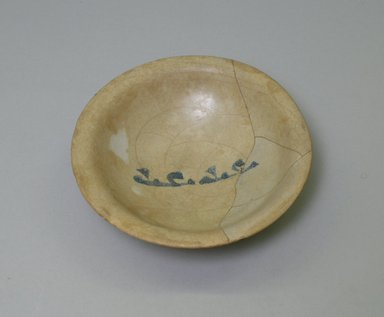 <em>Blue and White Bowl with Kufic Inscription</em>, 9th century. Ceramic; earthenware, painted in cobalt blue on an opaque white glaze., height: 1 5/16 in. (3.3 cm); diameter: 5 3/16 in. (13.2 cm). Brooklyn Museum, Gift of Ernest Erickson, 74.195. Creative Commons-BY (Photo: Brooklyn Museum, CUR.74.195_interior.jpg)