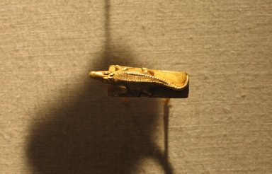 <em>Ring with Image of a Crocodile</em>, ca. 1539-1075 B.C.E. or later. Gold, 1 × 1 3/16 in. (2.5 × 3 cm). Brooklyn Museum, Charles Edwin Wilbour Fund, 74.21. Creative Commons-BY (Photo: Brooklyn Museum, CUR.74.21_wwg8.jpg)
