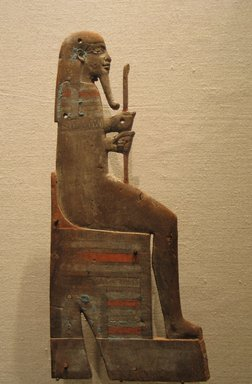 <em>Appliqué of a Seated God</em>, ca. 945-525 B.C.E. Wood, pigment, 11 5/8 × 5 1/4 × 2 3/4 in. (29.5 × 13.4 × 7 cm). Brooklyn Museum, Charles Edwin Wilbour Fund, 74.22. Creative Commons-BY (Photo: Brooklyn Museum, CUR.74.22_wwg8.jpg)