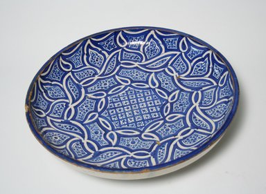 <em>Plate with Abstract Arabesque Leaf Pattern</em>, 18th century. Ceramic, slip, glaze, 3 11/16 x 15 3/8 in. (9.3 x 39 cm). Brooklyn Museum, Anonymous gift in honor of Charles K. Wilkinson, 74.2. Creative Commons-BY (Photo: Brooklyn Museum, CUR.74.2_view1.jpg)