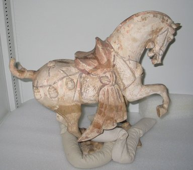 <em>Tomb Figurine of a Spirit Horse</em>, 618-907. Earthenware with applied pigment, 16 9/16 x 16 1/4 in. (42 x 41.3 cm). Brooklyn Museum, Gift of Mrs. Frank L. Babbott, Jr., 75.169. Creative Commons-BY (Photo: Brooklyn Museum, CUR.75.169.jpg)