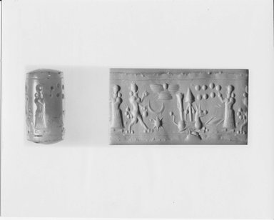 Ancient Near Eastern. <em>Cylinder Seal: Worshipper Facing a Recumbent Dragon</em>, late 7th century B.C.E. Chalcedony, 1 1/8 x Diam. 9/16 in. (2.8 x 1.5 cm). Brooklyn Museum, Ella C. Woodward Memorial Fund, 75.30.1. Creative Commons-BY (Photo: Brooklyn Museum, CUR.75.30.1_NegA_print_bw.jpg)