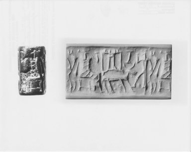 Ancient Near Eastern. <em>Cylinder Seal: Seated Figure Facing an Offering Table</em>, 2000-1850 B.C.E. Stone, 5/8 x Diam. 1 1/16 in. (1.6 x 2.7 cm). Brooklyn Museum, Ella C. Woodward Memorial Fund, 75.30.2. Creative Commons-BY (Photo: Brooklyn Museum, CUR.75.30.2_NegA_print_bw.jpg)