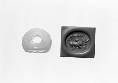 Ancient Near Eastern. <em>Stamp Seal: Recumbent Humped Bull with Tree and Leafy Branch</em>, 3rd-7th century C.E. Chalcedony, 13/16 x 3/4 x 13/16 in. (2.1 x 1.9 x 2 cm). Brooklyn Museum, Designated Purchase Fund, 75.55.10. Creative Commons-BY (Photo: Brooklyn Museum, CUR.75.55.10_negC_bw.jpg)