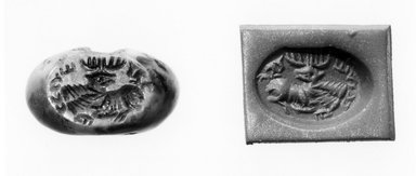 Ancient Near Eastern. <em>Stamp Seal: Recumbent Stag with Ribbons</em>, 3rd-7th century C.E. Stone, 11/16 x 7/16 x 9/16 in. (1.8 x 1.1 x 1.5 cm). Brooklyn Museum, Designated Purchase Fund, 75.55.12. Creative Commons-BY (Photo: Brooklyn Museum, CUR.75.55.12_negA_bw.jpg)