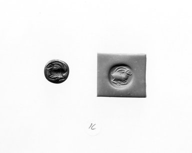 Ancient Near Eastern. <em>Stamp Seal: Recumbent Antelope</em>, 3rd-7th century C.E. Hematite, 5/16 x Diam. 7/16 in. (0.8 x 1.1 cm). Brooklyn Museum, Designated Purchase Fund, 75.55.16. Creative Commons-BY (Photo: Brooklyn Museum, CUR.75.55.16_negA_bw.jpg)