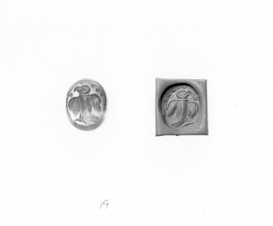 Ancient Near Eastern. <em>Stamp Seal: Eagle with Spread Wings</em>, 3rd-7th century C.E. Chalcedony, 9/16 x 1/2 x 9/16 in. (1.4 x 1.3 x 1.5 cm). Brooklyn Museum, Designated Purchase Fund, 75.55.19. Creative Commons-BY (Photo: Brooklyn Museum, CUR.75.55.19_negA_bw.jpg)